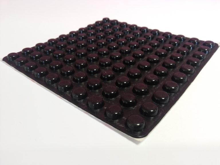A sheet of black bumpons