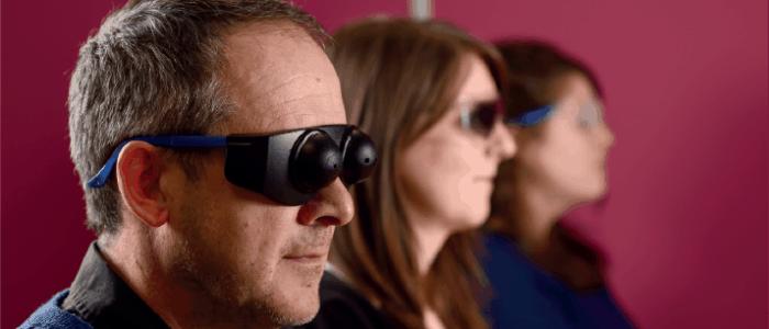 three people wearing sim specs