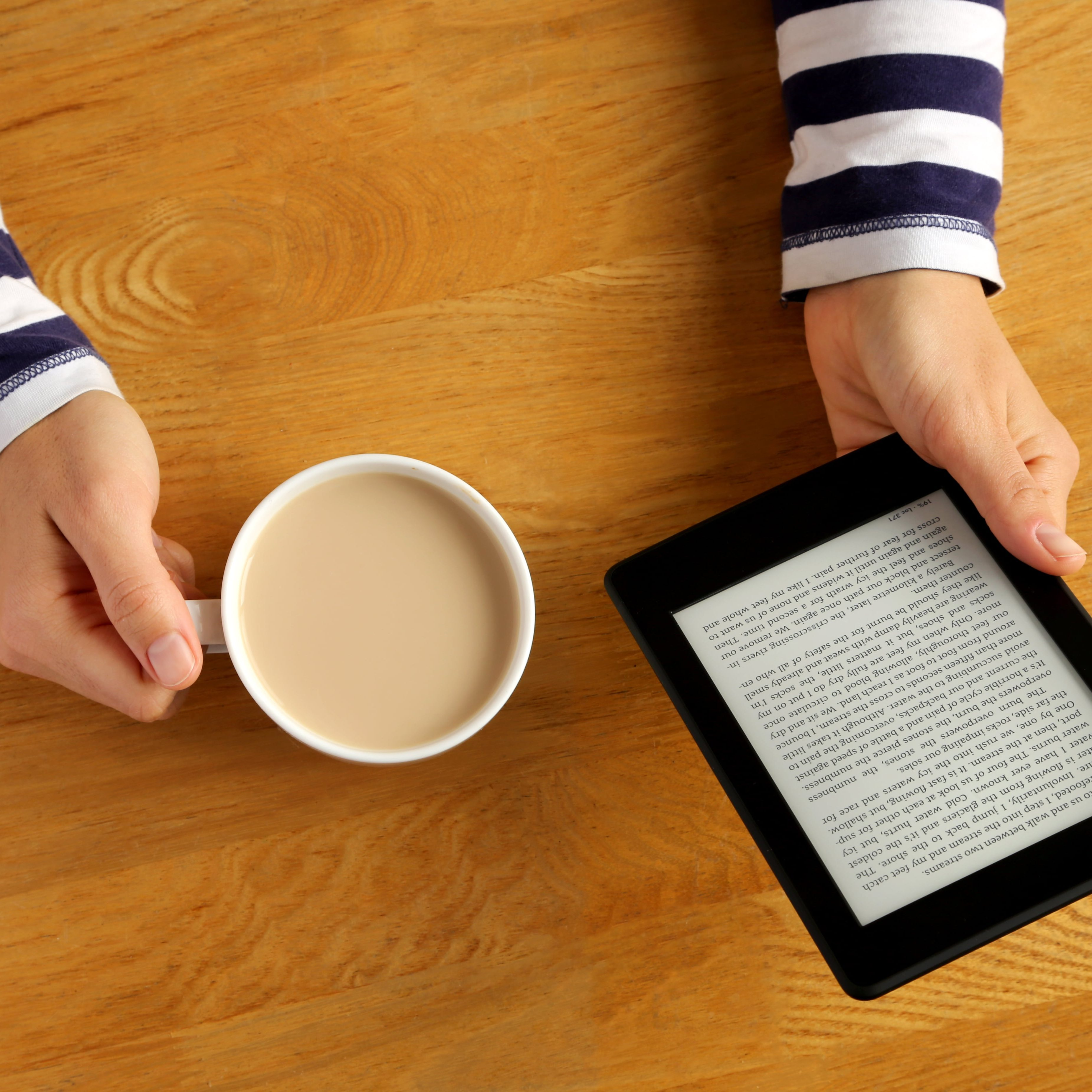 Transcription services and digital accessible formats. Image shows woman reading kindle.
